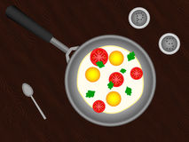 Eggs. With tomato, pepper and salt on the table Royalty Free Stock Photo