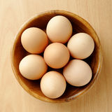 Eggs. Top view of eggs inside wooden bowl Stock Photos