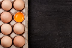 Eggs in a tray on a dark background with copy space for your text. Top view Stock Photo