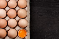 Eggs in a tray on a dark background with copy space for your text. Top view Stock Image