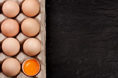 Eggs in a tray on a dark background with copy space for your text. Top view Royalty Free Stock Images