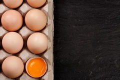 Eggs in a tray on a dark background with copy space for your text. Top view Royalty Free Stock Photos