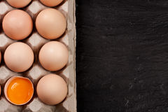 Eggs in a tray on a dark background with copy space for your text. Top view Stock Images
