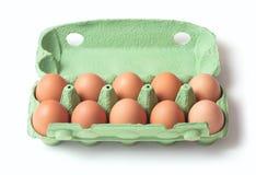 Eggs in tray stock photos