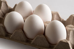 Eggs in a tray. Eggs. Eggs in a tray. White eggs, brown eggs, white and brown eggs, tray of eggs, opened tray of eggs, package of eggs, ten eggs, pack of eggs stock photos