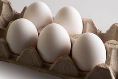 Eggs in a tray. Eggs. Eggs in a tray. White eggs, brown eggs, white and brown eggs, tray of eggs, opened tray of eggs, package of eggs, ten eggs, pack of eggs Stock Photos