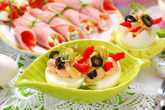 Eggs with tuna spread and olives for easter breakfast. Eggs stuffed with tuna spread and olives as appetizer for easter breakfast Stock Photos