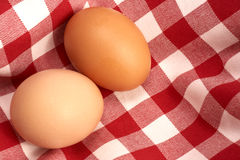 Eggs. Two brown eggs on a tablecloth Stock Photo