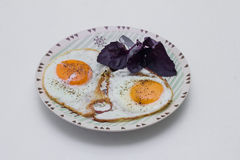 Eggs from two eggs with basil Stock Images