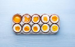 Eggs in varying degrees of availability depending on the time of boiling eggs Stock Photo