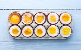 Eggs in varying degrees of availability depending on the time of boiling eggs Royalty Free Stock Photos