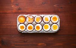 Eggs in varying degrees of availability depending on the time of boiling eggs Royalty Free Stock Photo