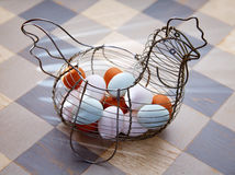 Eggs in a vintage hen shape basket Royalty Free Stock Photography