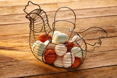 Eggs in a vintage hen shape basket on wood stock photos