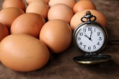 Eggs with vintage watch pocket Royalty Free Stock Image