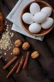 Eggs, walnuts and cinnamon Stock Photos