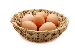 Eggs in a wattled basket Royalty Free Stock Photo