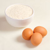Eggs and wheat flour in a plate Stock Image