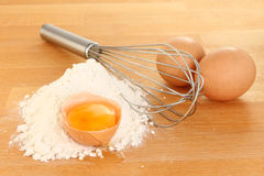 Eggs and whisk Stock Photos