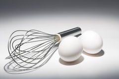 Eggs and Whisk Royalty Free Stock Photos