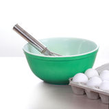 Eggs, whisk and bowl Royalty Free Stock Image