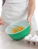 Eggs, whisk and bowl Royalty Free Stock Images