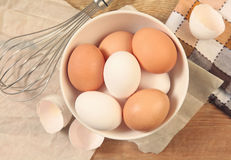 Eggs and whisk Royalty Free Stock Photography