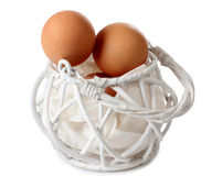 Eggs in white basket Royalty Free Stock Image