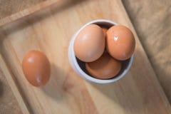 Eggs in white bowl. Stock Photos