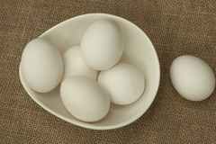 Eggs in a white bowl isoated on table mat. Front View. Eggs in a white bowl isoated on table mat Stock Image