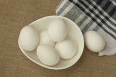 Eggs in a white bowl isoated on table mat. Royalty Free Stock Image