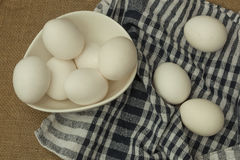 Eggs in a white bowl with napkin on table mat. Royalty Free Stock Images