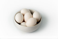 Eggs in White Bowl on White Background Stock Photography