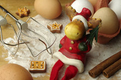 Eggs. White and brown ckicken eggs and gingerbread and santa royalty free stock image