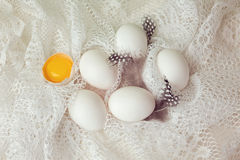 Eggs on white cloth. Easter holiday background Stock Images