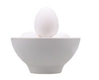 Eggs in white cup Stock Photos