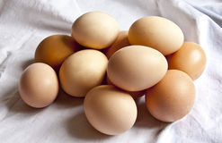 Eggs on white drapery. Still life with heap of farm fresh eggs on white drapery Royalty Free Stock Image