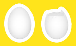 Eggs  on white with yellow background. Two eggs  on white with yellow background, one cracked and one intact Royalty Free Stock Photos
