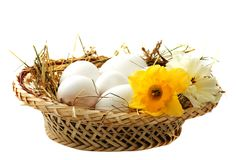Eggs in a wicker basket Royalty Free Stock Images