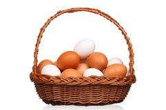 Eggs in wicker basket Stock Photos