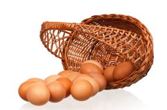 Eggs in wicker basket Royalty Free Stock Images