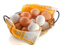 Eggs in wicker basket Stock Photo