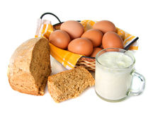 Eggs in wicker basket. With bread and clabber on white background Stock Photos