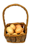 Eggs in a Wicker basket Isolated on White Stock Photography