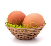 Eggs in wicker basket Royalty Free Stock Image