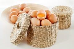 Eggs in a wicker basket Stock Image