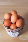 Eggs. In a wicker basket on the table Stock Image