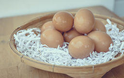 Eggs in a wicker basket. Stock Image