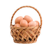 Eggs in wickerwork basket Royalty Free Stock Image