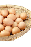 Eggs in the winnowing basket isolate Stock Images